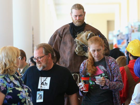 Scott Lund walks with other cosplayers during the Realms Con on Saturday, Oct. 3, 2015, at the American Bank Center in Corpus Christi.
