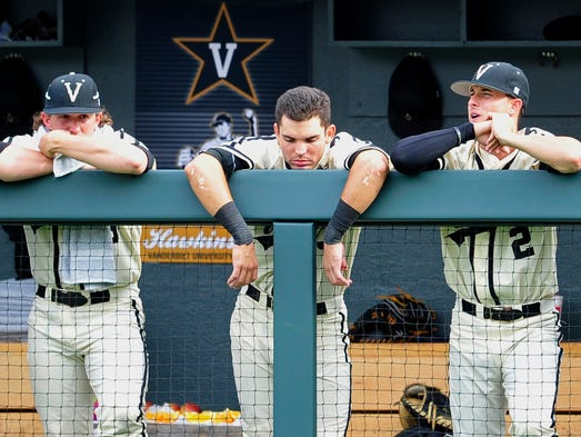 Vanderbilt's Carson Fulmer, left, Vince Conde, center, and Tyler Campbell are dejected in the ninth inning against Stanford during the Super Regional on Saturday.Vanderbilt lost 5-4.