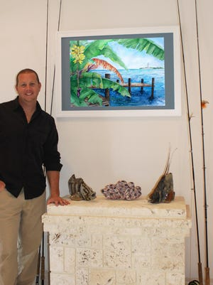 A graduate of Eastern Florida State College and the Art Institute of Fort Lauderdale, Eric LaMarr with just a few of his tropical pieces.