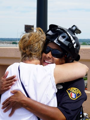 A protester and a police officer hug following the conclusion of a silent vigil in Cleveland on Sunday afternoon.