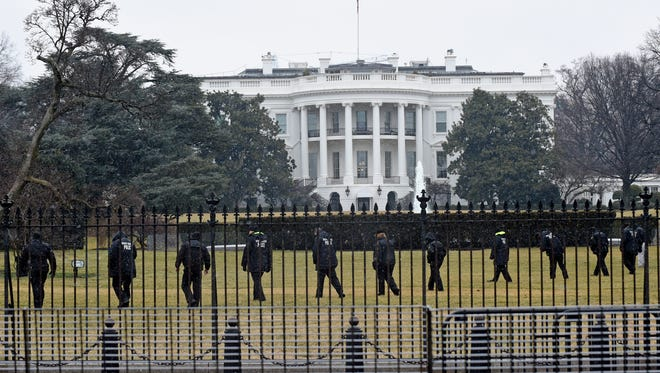 Secret Service officers search the south grounds of the White House on Jan. 26, 2015.