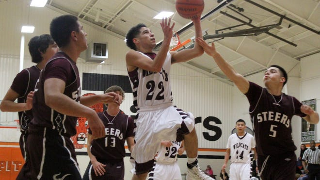 Tularosa's Mondo Brusuelas attempts a layup Thursday evening at Capitan High School's Cummin Gym.