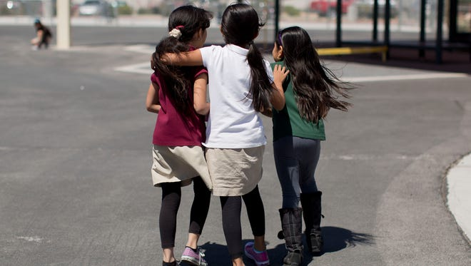 From left, Gisele Deras Saenz, Allyson Galvez and Xochilt Hernandez walk through the playground together during recess at Jay W. Jeffers Elementary School in Las Vegas in May 2013. Nevada is home to the highest density of English language learners in the country, at 31%.