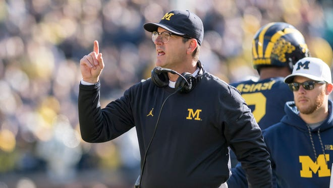 Jim Harbaugh likes what he sees on the Michigan sideline on Saturday against Illinois.
