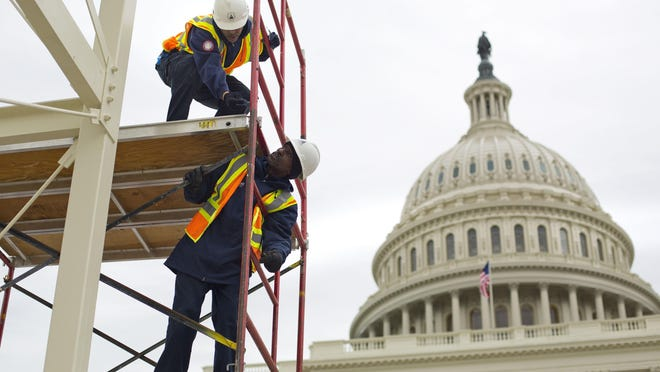Construction takes place in December for the inauguration ceremonies for President-elect Donald Trump on the Capitol steps in Washington. Several Michiganders will be part of the ceremony and the parade.