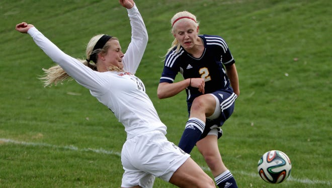 Hartland's Maddie Pogarch (2), who was thwarted by Brightons Holly Hermans on this play on Tuesday, scored both goals for the Eagles in a win at Ann Arbor Pioneer on Saturday.