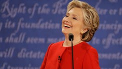 Clinton laughs to Trump during the presidential debate