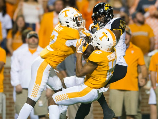 Tennessee defensive backs Emmanuel Moseley (12) and  Nigel Warrior (18) break up a pass intended for Southern Miss wide receiver Korey Robertson (18) during the game between Tennessee and Southern Miss at Neyland Stadium in Knoxville, Tennessee, on Saturday, Nov. 4, 2017.