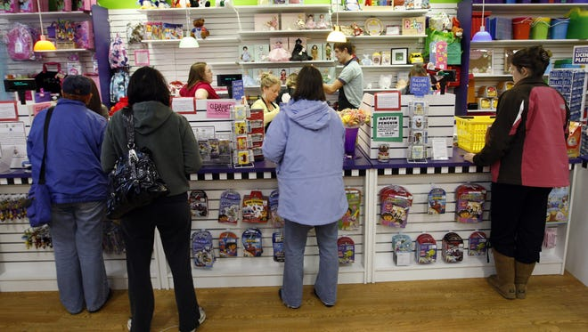 Learning Express Toys in Crestview Hills has new owners. Pictured are shoppers lining inside the store on Dec. 24, 2008.