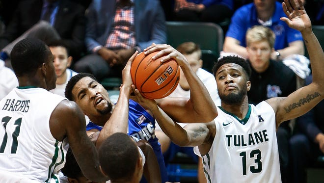 University of Memphis forward Dedric Lawson (left) grabs a rebound away from Tulane University forward Malik Morgan (right) during second half action at Fogelman Arena in Devlin Fieldhouse in New Orleans, La.