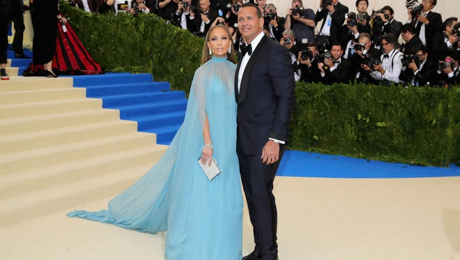 Jennifer Lopez (L) and Alex Rodriguez attend the Met Gala.