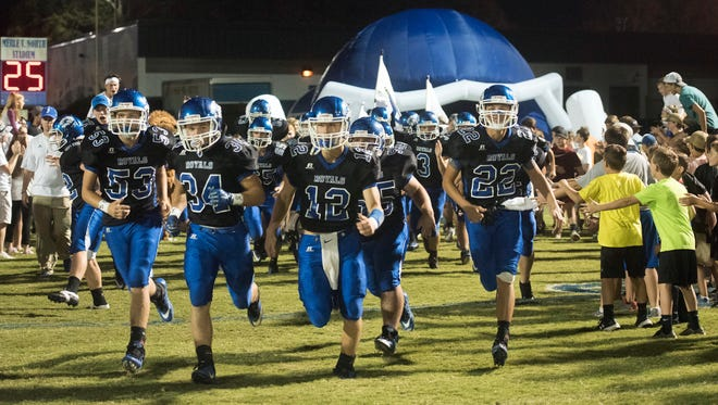 The Jay High School football team enters Royal Stadium on Friday night before their game against Blacksher.