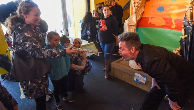 Amy Elliott of Dagsboro with her daughter, Bre Elliott, 8, pulls a sword out of Tyler Fyre's mouth at the Odditorium Grand Reopening of Ripley's Believe It or Not! on the Boardwalk in Ocean City Saturday, March 10, 2018.