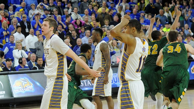 SDSU's #4 Jake Bittle, #0 Deondre Parks and #11 George Marshall leave the court after losing against NDSU during the Summit League men's basketball championship on Tuesday, March 10, 2015, at the Denny Sanford Premier Center in Sioux Falls, S.D.