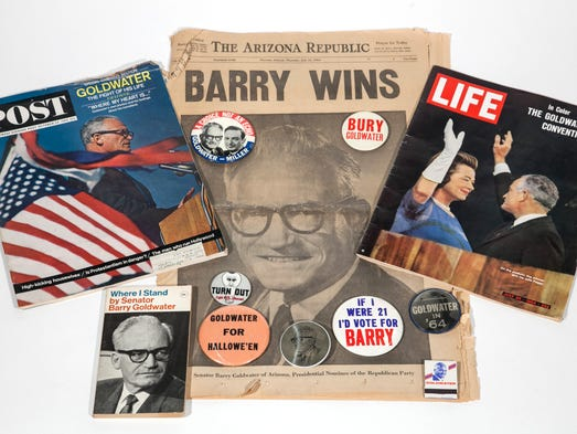 A wide variety of campaign buttons, magazine covers and the A1 of the 1964 Arizona Republic announcing Goldwater has won the Republican party nomination. These elements belong to senior reporter Dan Nowicki and digital editor Ginger Rough and were photographed in March 2014 in the AZR studio.