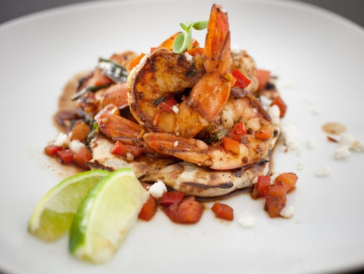 Rum glazed prawns and Roti flatbread are seen at The Breadfruit in Phoenix.
