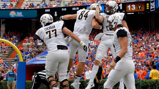 Vanderbilt wide receiver Caleb Scott (9) catches the ball for a touchdown against the Florida Gators during the first half Sept. 30, 2017, at Ben Hill Griffin Stadium.