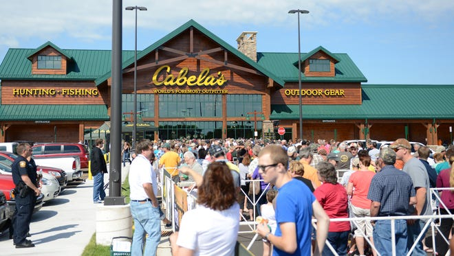 Crowds line up for the grand opening of Cabela's in Ashwaubenon.