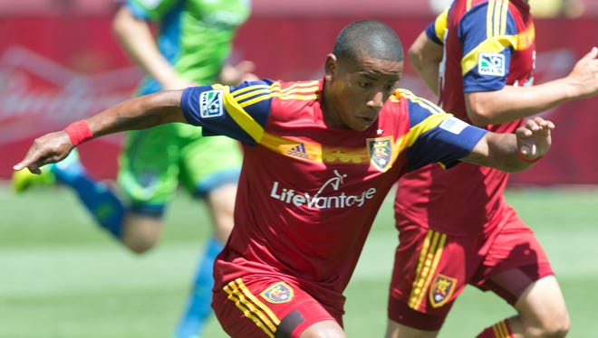 Real Salt Lake forward Joao Plata (8) dribbles the ball during the second half against the Seattle Sounders FC at Rio Tinto Stadium. Real Salt Lake won 2-1.