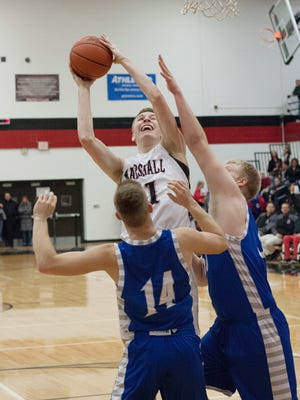 Marshall junior  Jack Luciani shoots over Harper  Creek's Ryan McCafferty in the Redhawks Interstate 8 Conference win on Friday.