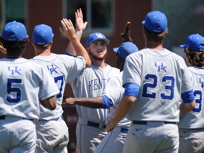 Kentucky pitcher A.J. Reed (center) celebrates a Cats' win over Kent State on Saturday during the Louisville Regional at Jim Patterson Stadium. May 31, 2014