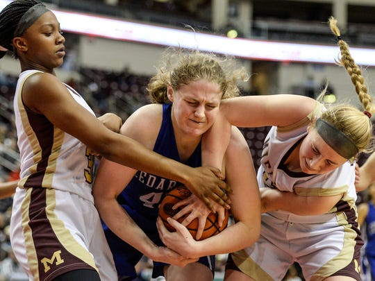 Cedar Crest's Alyssa Austin battles Governor Mifflin'sTa'Shonna Wright-Gaskins (left) and Madison Koehler (right) during the Falcons' 57-50 loss to Governor Mifflin on Tuesday night at Giant Center.