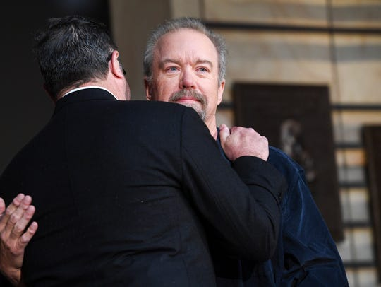Don Schlitz gets emotional as he hugs Vince Gill as
