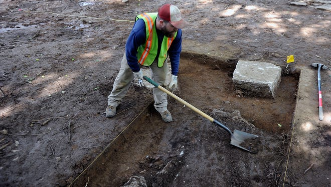 TRC archaeologist Sean McKeighen digs to uncover base of a cotton gin in Franklin on Wednesday. After the Civil War, soldiers wrote about the Battle of Franklin and the cotton gin.
