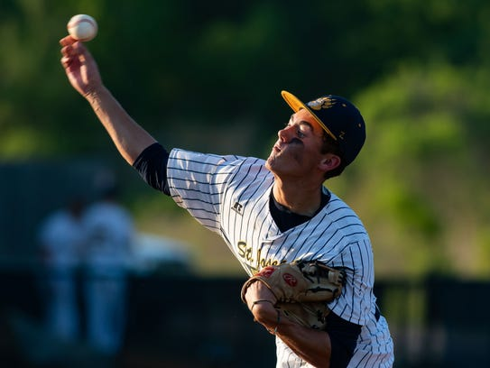 St Joseph's starting pitcher Josh Bailey (10) delivers