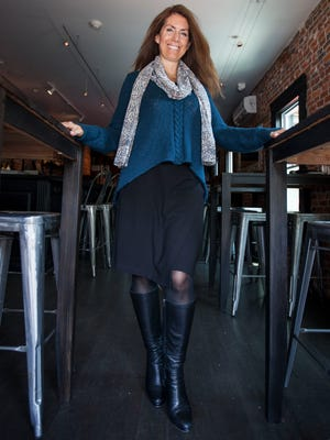 Marianne Lockwood wears a faux wrap Ponte knit skirt, Blue Crush cable stitch pullover and extra long polyester chiffon skin print scarf, all from CAbi (Carol Anderson by invitation).