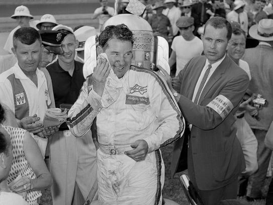 Rodger Ward wipes his face after winning the 1959 Indy 500. It was the only race Dale Toole has missed since he first saw the race from a tree in 1950.