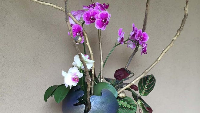 The Ikebana exhibit is a special garden exhibit with large scale installations featuring many varieties of flowers, branches, bamboo, and unconventional materials.