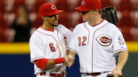 Reds center fielder Billy Hamilton (6) and right fielder Jay Bruce celebrate Tuesday's 3-2 win against the Cubs at GABP.