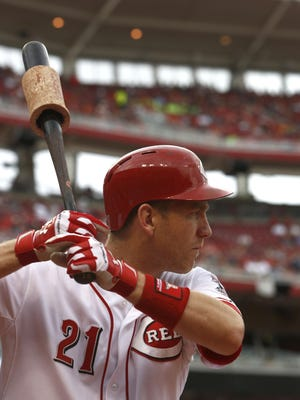 Reds third baseman Todd Frazier prepares on deck.