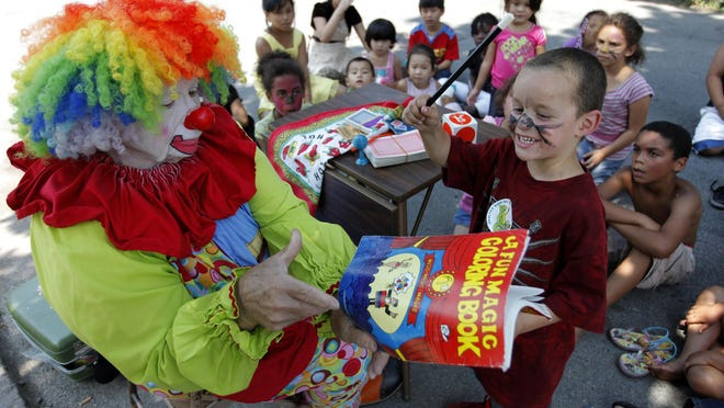 A clown helps liven up the Woodward Street Block Party in 2014. The street is part of the city's Focused Investment Strategy program.
