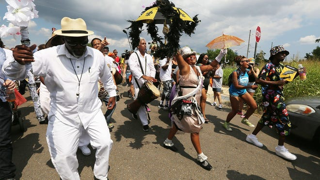 People march through the Lower 9th Ward during a second line parade on the 10th anniversary of Hurricane Katrina on Aug. 29, 2015, in New Orleans.