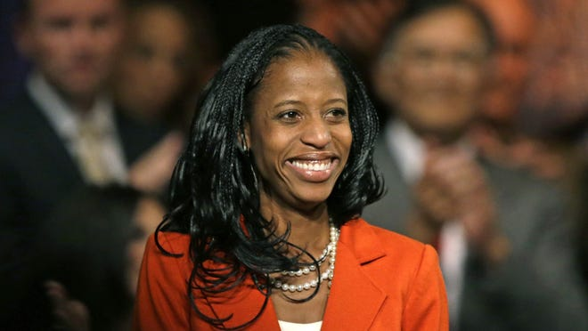 In this Wednesday, Oct. 8, 2014, photo, Mia Love, the Republican nominee in Utahís 4th congressional district, smiles after speaking during a rally, in Lehi, Utah.
