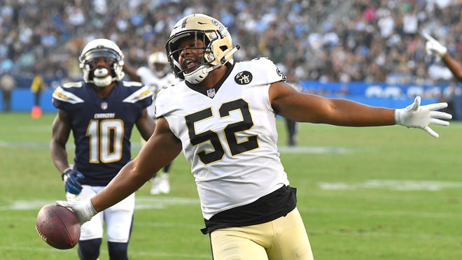 CARSON, CA - AUGUST 25: The run by Craig Robertson #52 of the New Orleans Saints into the end zone after an interception was called back because of a penalty in the third quarter of the preseason game against the Los Angeles Chargers at StubHub Center on August 25, 2018 in Carson, California.  (Photo by Jayne Kamin-Oncea/Getty Images)