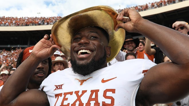 DALLAS, TX - OCTOBER 06:  Kris Boyd #2 of the Texas Longhorns wears the Golden Hat trophy after a win against the Oklahoma Sooners in the 2018 AT&T Red River Showdown at Cotton Bowl on October 6, 2018 in Dallas, Texas.  (Photo by Ronald Martinez/Getty Images)