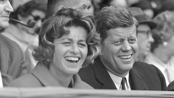 In this April 10, 1961, file photo, President John F. Kennedy and his sister, Jean Kennedy Smith, watch an opening day baseball game at Griffith Stadium in Washington.