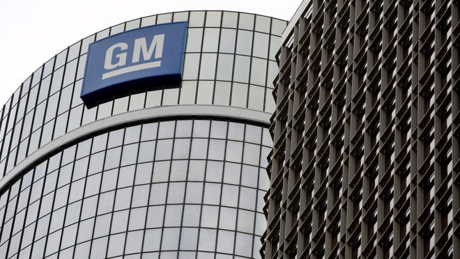 A file picture dated 19 November 2008 shows General Motors World Headquarters in the Renaissance Center in Detroit. The writer suggests GM retirees suffered financial harm when the company reorganized.