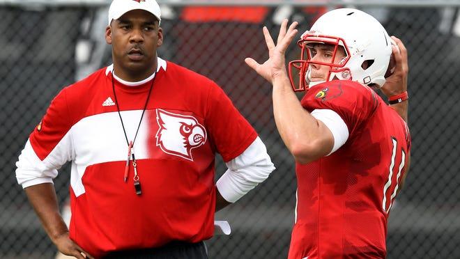 Assistant coach Garrick McGee watches Will Gardner throw in practice. August 7, 2014