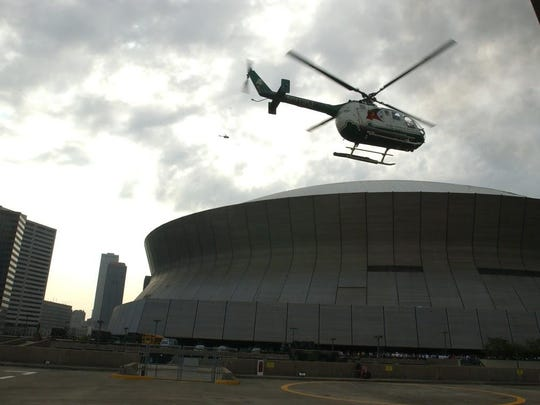 An Acadian AirMed helicoper flies near the Superdome after Hurricane Katrina.