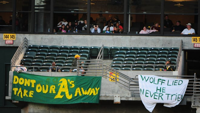 Oakland A's fans displayed signs to the reaction of owner Lew Wolff's (not pictured) action for the team's future in Oakland during the fifth inning against the Chicago White Sox at Oakland-Alameda County Coliseum.