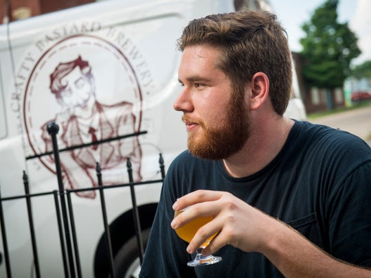 Knoxville News Sentinel urban life writer Ryan Wilusz tries out a beer at Crafty Bastard Brewery on his way to drink at every Knoxville brewery as he attempts the Knoxville bucket list in one day.