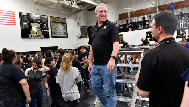 "Abilene High School band director Paul Walker steps down from a riser in the Eagle Gym at a pep rally at which  the cast of ""Brother's Keeper,"" a movie about the 2009 Eagles football championship season was named. Walker is retiring as band director in June, finishing 21 years at Abilene High School."