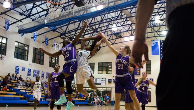 Fort Myers High School junior, Destanni Henderson, goes in for a layup during game 6 of the Naples Holiday Shootout at Community School of Naples in East Naples on Wednesday, December 28, 2016. Fort Myers lost to Central Arkansas Christian High School.