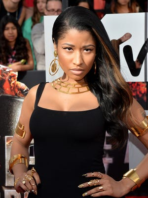 Nicki Minaj rocks a more natural look for the 2014 MTV Movie Awards on April 13, at Nokia Theatre L.A. Live.