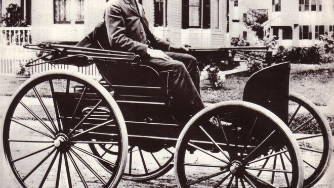 Charles Duryea sitting in the car that won a race sponsored by the Chicago Times Herald in 1895.