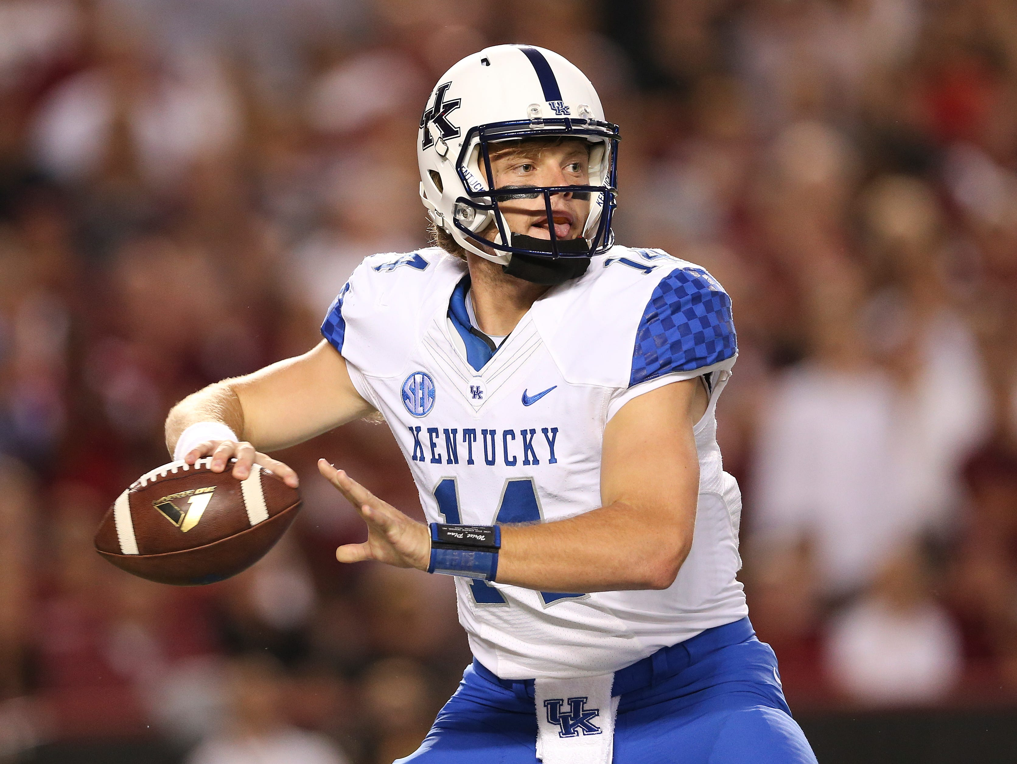 Kentucky Wildcats quarterback Patrick Towles (14) looks for an open receiver in the first half of an NCAA college football game against South Carolina Saturday, Sept. 12, 2015, in Columbia, S.C.